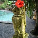 statue beside the pool