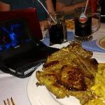 T-bone steak, salad chips and service
