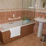 big bathroom with plenty toiletries