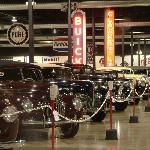 Automobiles are displayed in chronological order beginning with an 1886 Benz.