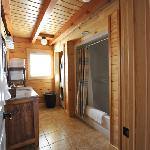 Bathrooms are spacious and also contain a washer/dryer for the cabin