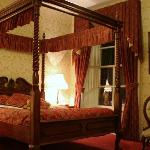 One of our bedrooms complete with four poster bed