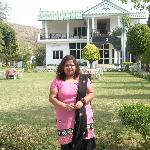 PAYEL WITH THE RESORT AT BACKGROUND
