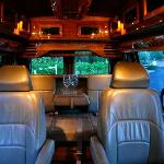 The inside of our luxury conversion van seats up to 6