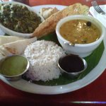 Buddha's Delight - curried vegetables (spinach, that day), dahl (lentil soup), samosa, pappadam,