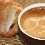 Fresh baked pastry and a latte