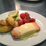 salmon in hollandaise sauce with garlic roasted new potatoes, buttered leeks and cherry tomatoes