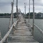 wooden bridge leading to the dining hall & beach