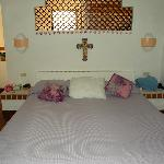 Master bedroom, bathroom area behind bed