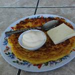 ready to eat Chorreada with sour cream and cheese