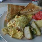 "the Sunrise Cafe Special omelet - crab, veggies, cheese inside. toast, fruit and ""hash browns"" o"