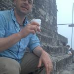 They bring coffee for the sunrise tour! Watching the sunrise at the top of Temple IV.