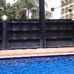 High fence around the pool blocks the street and parking lot noise; makes it very peaceful.