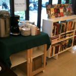 Complimentary coffee and tea and a small bookshelf