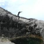 Alrick jumping of a rock
