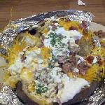 Giant Potato filled with BBQ Beef Brisket, cheese, sour cream and chives. HUGE!