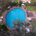 view of pool from bathroom window