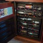 Stocked mini bar and fridge.