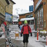 Grand Targhee's base village with happy skier.