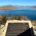 View from the viewpoint, with the lake plaque.