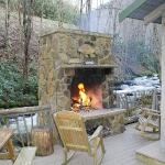 Fireplace, hotub and crystal clear stream....awesome setting