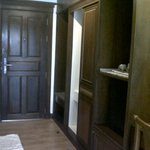 Entrance, wardrobe & mini-bar area of room #104
