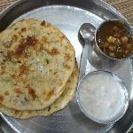 Amritsari kulche with chole and raita