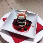 marangue with mix berrys and strawberry sauce