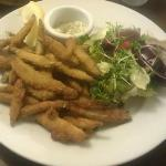 Breaded whitebait served with salad garnish and bread