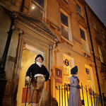 Outside the Jane Austen Centre at night
