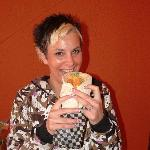 A happy customer with her Chicken Caesar Wrap