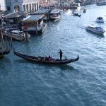 A gondalier takes a couple out onto the Grand Canal