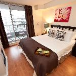 1 Bedroom Deluxe Suite - The Bedroom with a walkout to a spacious balcony with Magnificent View