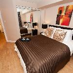 1 Bedroom Executive Suite - The Bedroom with Simmons Beautyrest Queen bed Ex, Fireplace & LCD TV