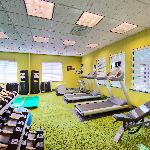 Fitness room which includes Eliptical machine with TV monitor, treadmills with monitors and free