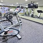 Our 24 hour Fitness Facility features a treadmill, stationary bike, elliptical trainer and unive