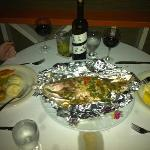 Our romantic dinner along with the fish we caught.