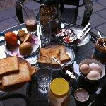 Free daily western breakfast, we prefer to dine outdoors in the courtyard.