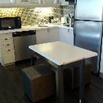 Room 229: Kitchen with rolling table pulled out