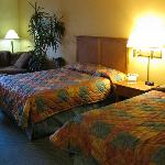 Queen sized beds in room at Miracle Springs Hotel and Spa
