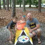 After our meal, we were happy to pose for pics outside by the Steelers corn hole set!