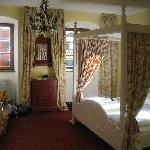 Our room with canopy bed
