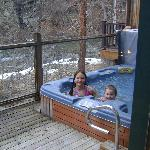 hot tub on deck overlooking river(still snow on the ground)