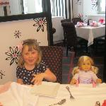 Granddaughter and her new American Girl doll having lunch