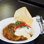 Authentic curry prepared by our Indian chefs