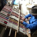 Miguel Andrago demonstrating his backstrap loom