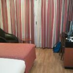 bed, sofa and curtains