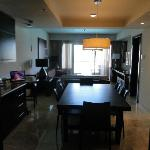 1 bedroom master suite conference table and living room with bar. super nice!!