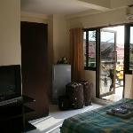Chambre avec terrasse à l'arrière