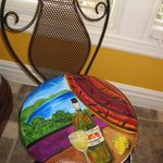 Dining chairs feature original art by Jane Hall.